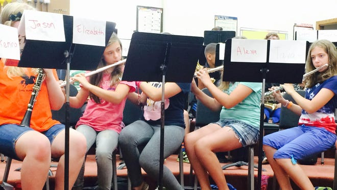 Young flutists rehearse a section of music for Summer Band Bash.
