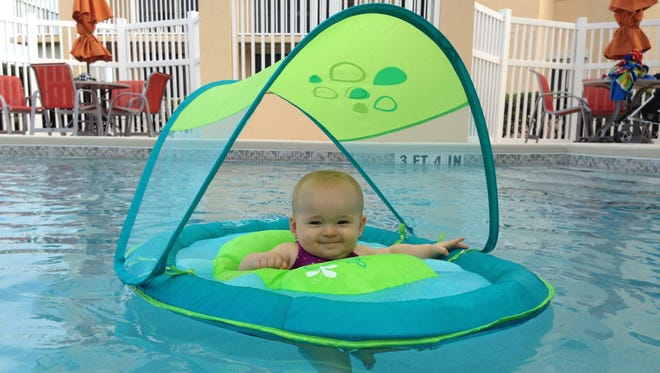 Isabella loves to take to the water in her covered floatie. She will be getting swimming lessons this summer.
