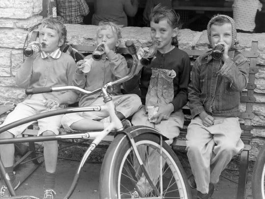 Youngsters enjoy refreshments at the shelter house in Wilson Park around 1960.