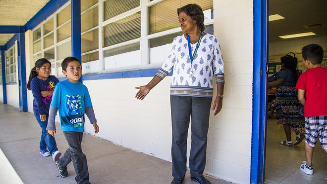 Lalani Moragoda is a kindergarten teacher at the Gila Bend Elementary School.  Because of a shortage of teachers, the district was forced to hire Moragoda from her native Sri Lanka. She ushers her students into class, Thursday, April 20, 2017.