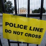 This sign is on a temporary fence installed in front of the White House. The U.S. Secret Service is reviewing new security measures inside and outside the White House fence after a man made it all the way inside the presidential mansion last week before being tackled.