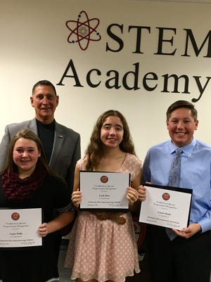 "U.S. Representative Frank A. LoBiondo, NJ-02, congratulates (from left) Logan Willis, Leslie Baez and Connor Bondi, a team from Cumberland Regional High School for winning the 2016 Congressional App Challenge with their app, ""County College Class Conversion."""