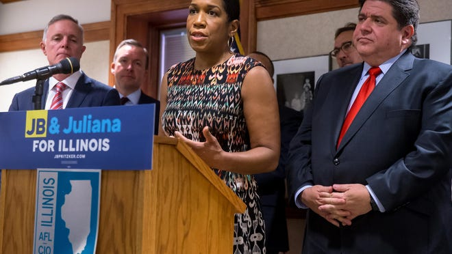 Lt. Gov. Juliana Stratton and Gov. JB Pritzker speak at an announcement together during the transition before both took office.