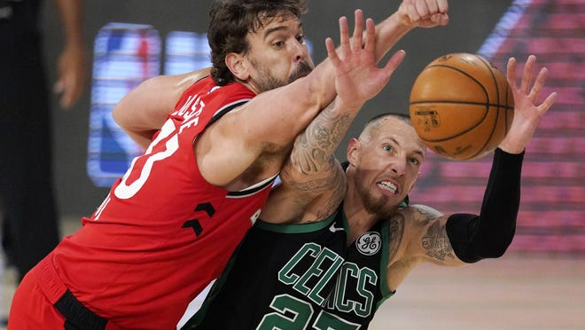 The Celtics' Daniel Theis and the Raptors' Marc Gasol battle for a rebound during the second half of Monday's Eastern Conference semifinal playoff game. Theis finished with 15 points, eight rebounds and two blocks.