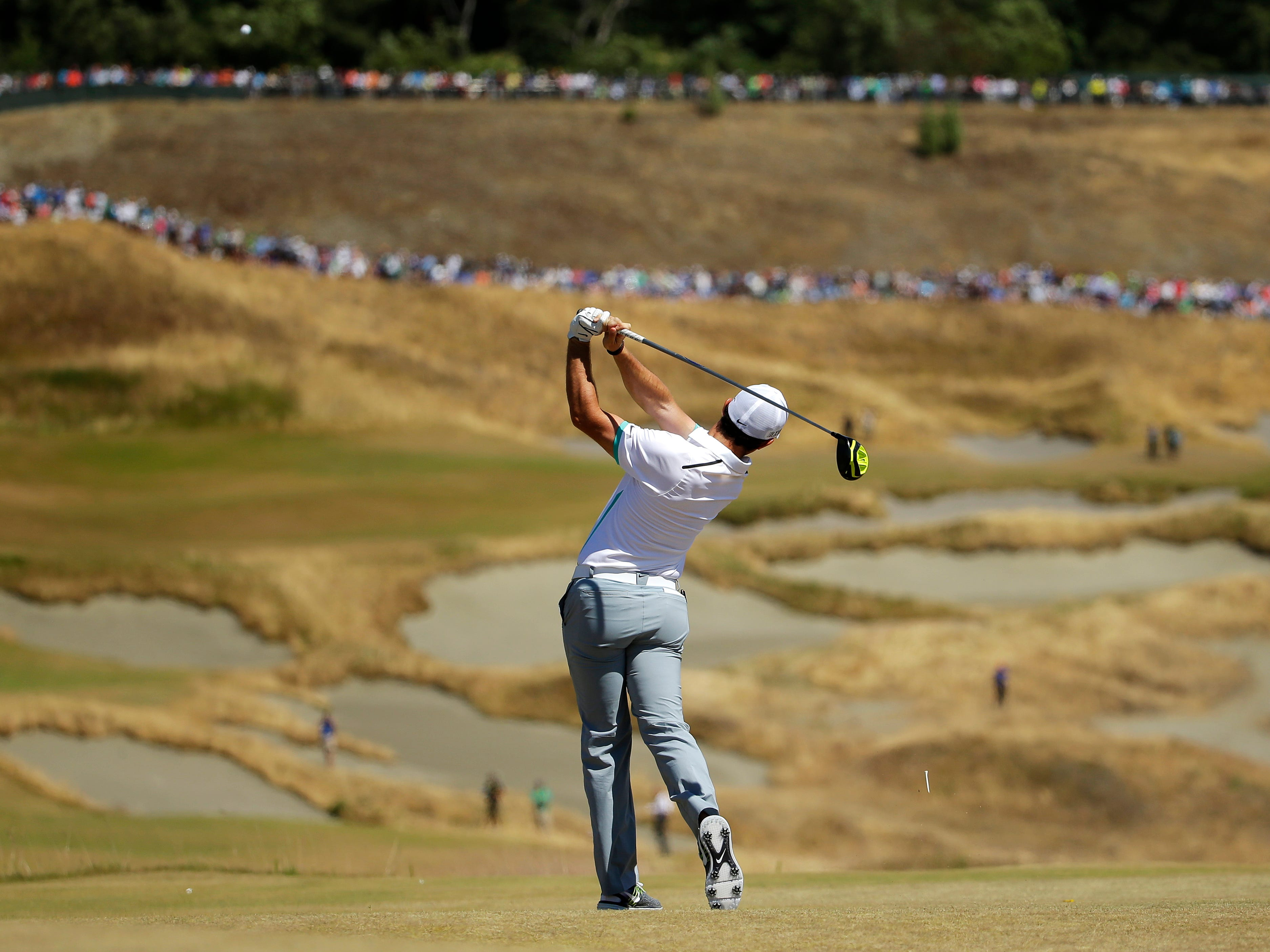 Rory McIlroy, of Northern Ireland, watches his tee shot on the fourth hole during the second round of the U.S. Open golf tournament at Chambers Bay on Friday, June 19, 2015 in University Place, Wash. (AP Photo/Ted S. Warren)