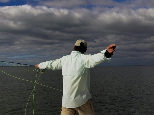 Writer Jack Ballard, of Red Lodge, Montana, pulls his floating fly-fishing line Wednesday afternoon in Pine Island Sound. Ballard was one of the members of the Outdoor Writers Association of America which met on Captiva. The group was participating in a saltwater fly-fishing outing put together by members of the Lee County Visitor and Convention Bureau.