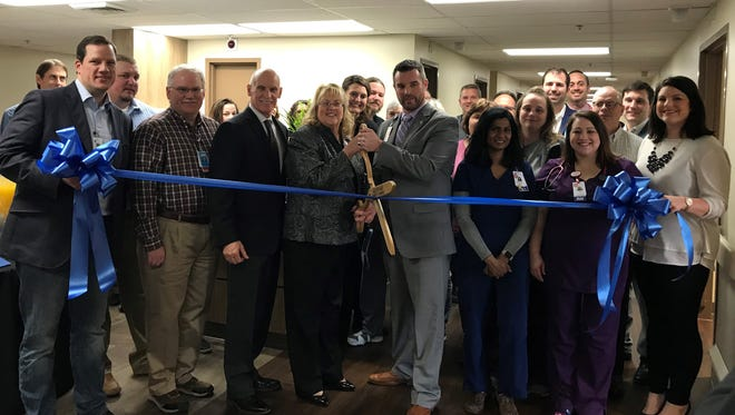 Pictured (L-R):  Hospital CEO Susan Peach and COO Ryan Williams cut the ribbon to Sumner Regional Medical Center's newly renovated Inpatient Rehabilitation Unit on Friday, January 26, surrounded by physicians, clinical staff, board members and community leaders.