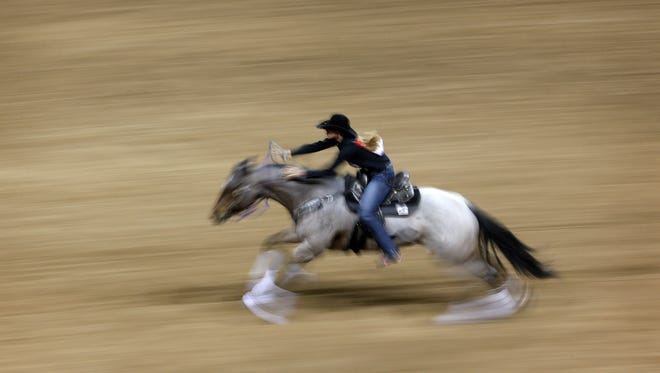 Sarah Rose McDonald competes in barrel racing during the first go-round of the National Finals Rodeo on Thursday in Las Vegas.