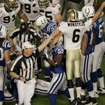 An offiical signals that the New Orleans Saints will have possesion of the ball after an on-side kick, as New Orleans Saints punter Thomas Morstead (6) reacts during the second half of the NFL Super Bowl XLIV football game against the Indianapolis Colts in Miami, Sunday, Feb. 7, 2010. (AP Photo/Charlie Riedel)