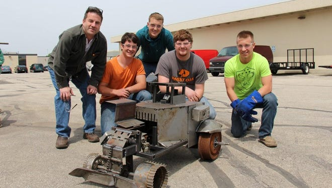Students from Fond du Lac High School came in first place with their bulldozer at Moraine Park Technical College's Junkyard Challenge. From left are instructor Eric Ciha and team members Jackson Schuelke, Nate Lobajeski, Nick Immel and Noah Poss.