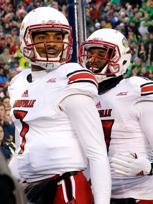 Louisville quarterback Reggie Bonnafon (7) celebrates with wide receiver James Quick, right, after scoring a touchdown during the first half of an NCAA college football game against Notre Dame in South Bend, Ind., Saturday, Nov. 22, 2014. (AP Photo/Nam Y. Huh)