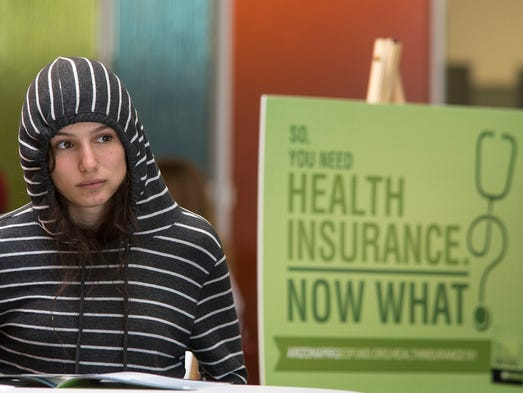 Willow Kanowshy  listens during an Affordable Care Act information session in the student union on Oct. 1 at Phoenix College in Phoenix.
