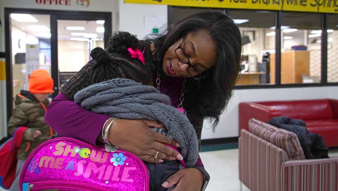 Stephanie Armstrong, principal at Brandywine Springs School, gives a hug to young student as she arrives for school. More than ever, Delaware school faculty are on the front line of spotting child abuse and are taking extra steps to protect their students from mistreatment.