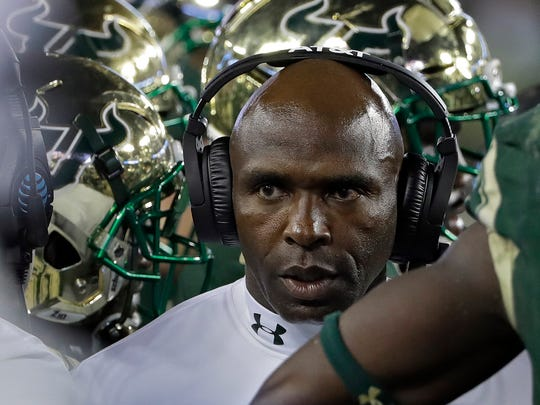 South Florida head coach Charlie Strong looks on during the first half of a game against Temple earlier this season.