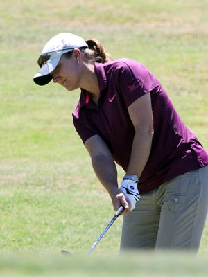 Jennifer Delgadillo chips her way to the 14th hole Saturday during the final round of the Sun City Women's Golf Championship at Horizon Golf Club. She won the championship.