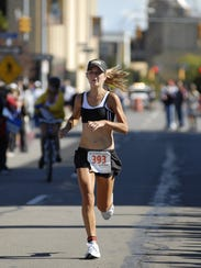 Jill Skivington of Rochester finishes first for the