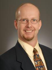 Dr. Charles Brady