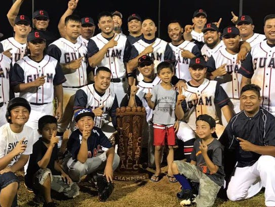 Team Guam celebrates with the championship trophy after