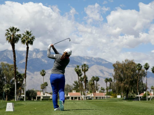 Inbee Park, of South Korea, watches her tee shot on the fifth hole during the pro-am at the LPGA Kraft Nabisco Championship golf tournament on Wednesday, April 2, 2014, in Rancho Mirage, Calif. (AP Photo/Chris Carlson)