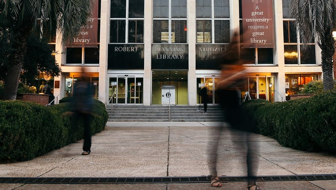 Strozier Library opened the day after bullets shattered its outside windows.
