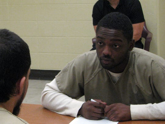 Cook County Jail inmate Romell Young conducts a mock