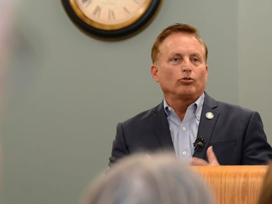 Iowa Secretary of State Paul Pate talks with a crowd of about 30 people Thursday afternoon in Adel about a change to the state's voting laws.