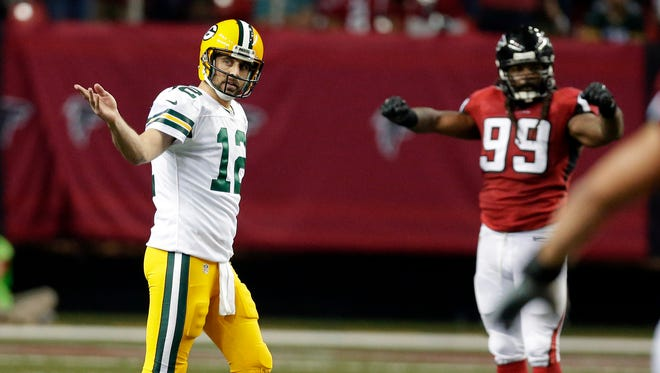 Green Bay Packers quarterback Aaron Rodgers (12) expresses his frustration on a dropped pass on 4th down at the end of the game as Atlanta Falcons celebrate  l the Green Bay Packers 33-32 loss to the Atlanta Falcons, Sunday, October 30, 2016 at the Georgia Dome in Atlanta Georgia.