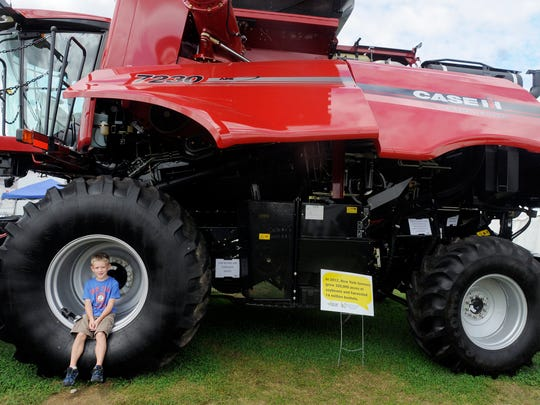 Young Pleasant Valley Brennan Paul is photopgraphed in the wheel of a combine at the Dutchess County Fair on Saturday in Rhinebeck. August 23, 2014