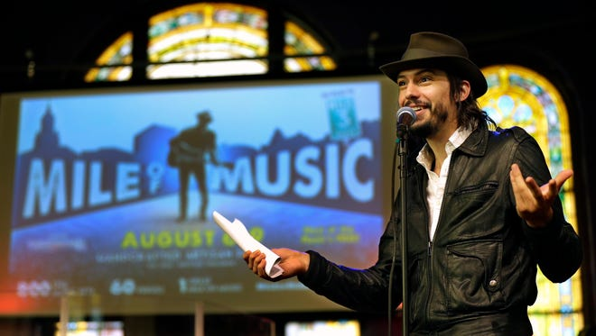 Cory Chisel talks during the Mile of Music kickoff announcement Thursday at OuterEdge Stage in downtown Appleton.