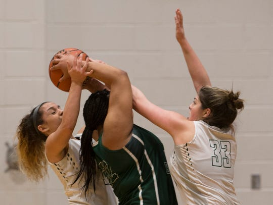 Long Branch's Angelique Gathers gets double-teamed