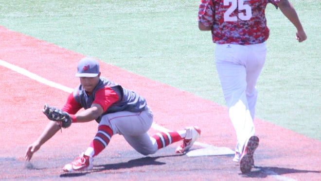 Cobre's Chris Dominguez stretches to make this catch during action at the semifinals of the state baseball tourney in Rio Rancho on Friday.