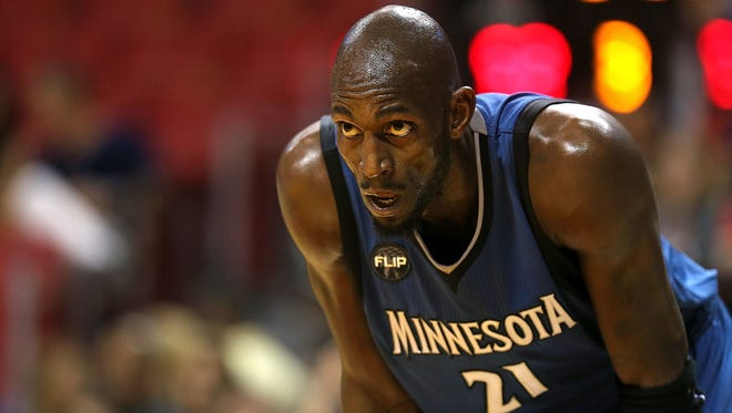 Kevin Garnett of the Minnesota Timberwolves looks on during a game against the Miami Heat at American Airlines Arena on November 17, 2015 in Miami, Florida.