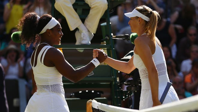 In a file photo from 2015,  Serena Williams celebrates at the net after winning a semifinal match against Maria Sharapova during the Wimbledon Lawn Tennis Championships at the All England Lawn Tennis and Croquet Club.