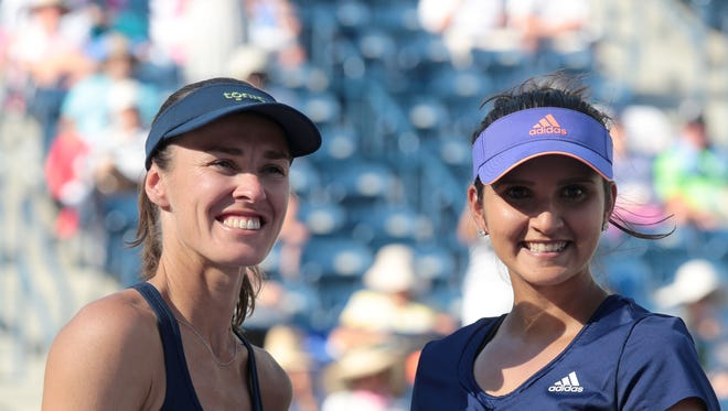 Martina Hingis, of Switzerland, and Sania Mirza, of India, are this years BNP Paribas Open Women's Doubles Champions. They beat the Russian pair of Elena Vesnina and Ekaterina Makanrova 6-3, 6-4 for the title.