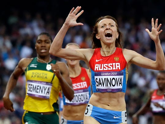 FILE - In this Saturday, Aug. 11, 2012 file photo, Russia's Maria Savinova celebrates as she crosses the finish line ahead of South Africa's Caster Semenya to win the women's 800-meters final at the 2012 Summer Olympics, London. Russian runner Maria Savinova has been given a date to appeal against her 4-year doping ban and being stripped of the 2012 Olympic 800-meter title she won ahead of Caster Semenya. The Court of Arbitration for Sport said Monday, Nov. 6, 2017 Savinova's appeal against the IAAF and the Russian track federation will be heard Dec. 4. A verdict should follow within weeks. (AP Photo/Anja Niedringhaus, File)