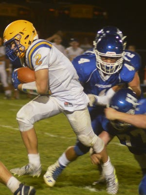 Lyndhurst sophomore running back Piotr Partyla breaking through the Hawthorne defensive line.