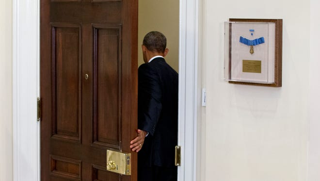 President Obama leaves the Roosevelt Room of the White House in Washington Wednesday, after speaking about the completion of the Hostage Policy Review The president is clearing the way for families of U.S. hostages to pay ransom to terror groups without fear of prosecution, as the White House seeks to address criticism from those whose loved ones have been killed in captivity.