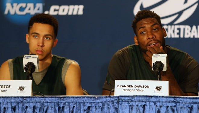 Michigan State seniors Travis Trice and Branden Dawson speak at a press conference today at the Time Warner Cable Arena in Charlotte North Carolina.