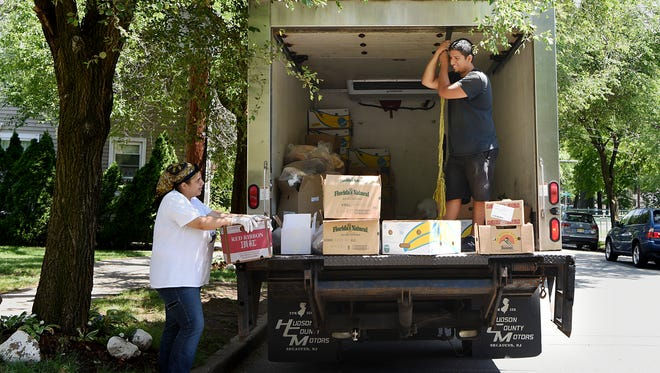 Table to Table delivers surplus food from ShopRite in Wallington to First Seventh Day Adventist Church Food Pantry in Montclair. Alexus Yaya, a volunteer with the food pantry and Bruno Facundo, a driver with Table to Table,  unload the truck on Thursday June 21, 2018.