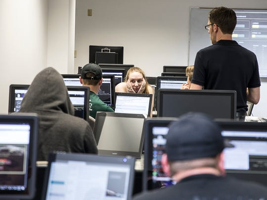 Tiffin University student Nicole McCombs, center, is one of many college age students who participated in the cybersecurity exercise at Ohio University Chillicothe.