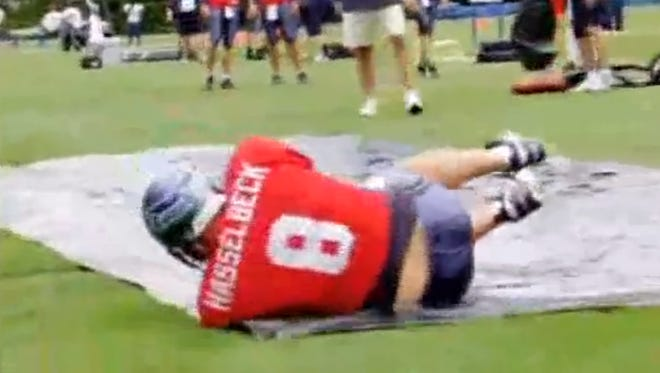 Matt Hasselbeck using a Slip 'n' Slide to practice sliding while with the Seattle Seahawks.