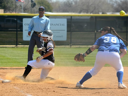 Abilene High's K'Ci Walker slides into third base ahead of the throw during the Lady Eagles' 14-0 win over Weatherford on Tuesday at the AHS softball field.
