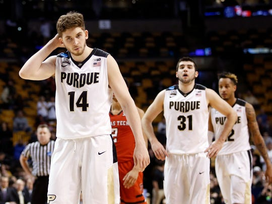 Purdue Boilermakers guard Ryan Cline (14), guard Dakota Mathias (31), and forward Vincent Edwards (12) walk off the court after being defeated by the Texas Tech Red Raiders in the semifinals of the East regional of the 2018 NCAA Tournament at the TD Garden.