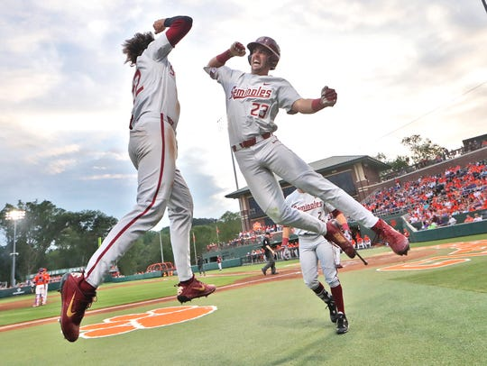 FSU's Drew Mendoza, left, leaps in the air to meet