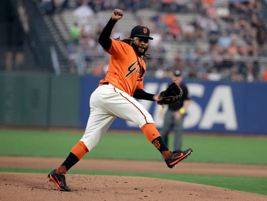 San Francisco Giants starter Johnny Cueto watches a pitch to the St. Louis Cardinals during the first inning of a baseball game Friday, Sept. 1, 2017, in San Francisco. (AP Photo/Marcio Jose Sanchez)