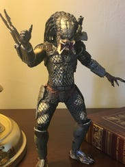 This Predator action figure sits on Republican Congressman