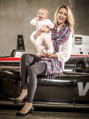 "Nicole Briscoe, Host of ""NASCAR Countdown"" on ESPN, wife of Ryan Briscoe, holding daughter Finley."