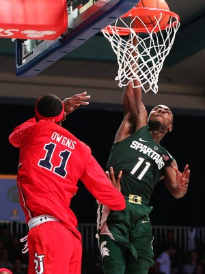 Michigan State guard Tum Tum Nairn dunks over St. John's forward Tariq Owens during the second half in the Battle 4 Atlantis in the Imperial Arena at the Atlantis Resort in the Bahamas.
