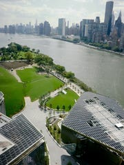 This Wednesday Aug. 16, 2017, photo shows a southern view of Cornell Tech's campus from a 26-story residence hall on Roosevelt Island in New York. The new graduate school that backers hope will cement New York's status as a center of high-tech innovation officially opens Wednesday, Sept. 13. Cornell Tech is the product of a competition former Mayor Michael Bloomberg announced in 2011. (AP Photo/Bebeto Matthews)