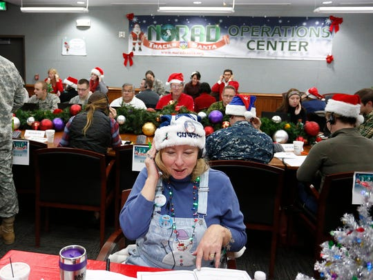 FILE - In this Dec. 24, 2014, file photo, volunteer